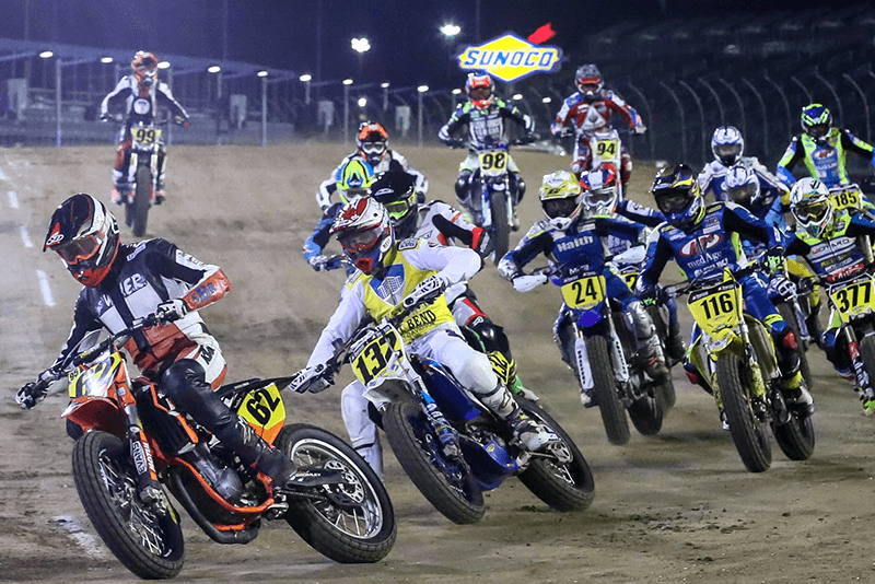 Several riders on dirt bikes during a racing event